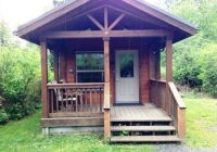 a fire pit picnic table and a bbq grill are not shown but are Wallace Falls State Park Cabins