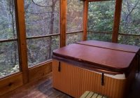 hot tub on screened porch picture of cabins at green mountain Cabins At Green Mountain Branson Mo
